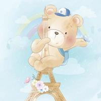 ours mignon suspendu à l'illustration de la tour de paris vecteur