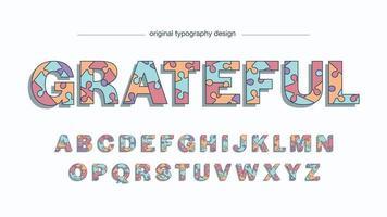 typographie en majuscules de dessin animé de puzzle coloré vecteur