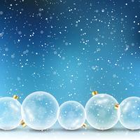 Boules de Noël sur fond neigeux