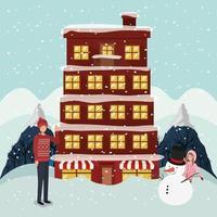 couple célébrant noël et bâtiment et bonhomme de neige