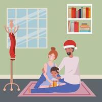 famille interraciale célébrant Noël à la maison