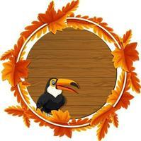 modèle de bannière de feuilles dautomne rond avec un personnage de dessin animé toucan