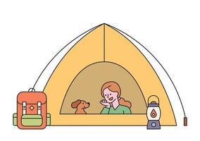 une femme campe avec son chien. la femme et le chien se reposent dans la tente. illustration vectorielle minimale de style design plat. vecteur