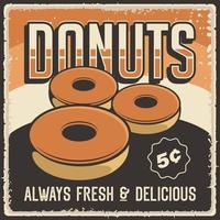affiche de signe commercial rétro de beignets vecteur