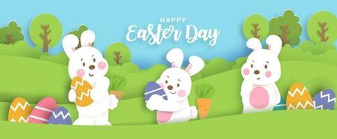 carte de jour de Pâques avec des lapins mignons et des oeufs de Pâques. vecteur