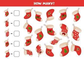jeu de comptage avec des chaussettes de Noël de dessin animé. jeu de maths.