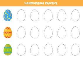 traçant des lignes avec des oeufs de Pâques. pratique des compétences d'écriture.