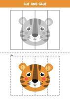 jeu de coupe et de colle pour les enfants. visage de tigre mignon.