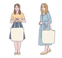une jolie petite fille est debout avec un sac. vecteur