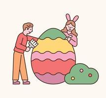 personnages de Pâques. le garçon et la fille colorient des œufs de Pâques. illustration vectorielle minimale de style design plat. vecteur