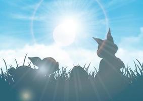 Fond de Pâques avec des silhouettes de lapins contre un ciel bleu ensoleillé vecteur