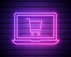 panier de néon lumineux sur l'icône d'ordinateur portable écran isolé sur fond de mur de brique. concept e-commerce, e-business, marketing d'entreprise en ligne. vecteur