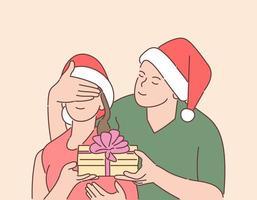 Noël, cadeau, concept de réveillon du nouvel an. jeune homme heureux a préparé la surprise pour sa petite amie. vecteur
