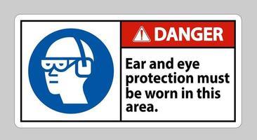 une protection auditive et oculaire de signe de danger doit être portée dans cette zone vecteur