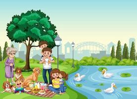 scène de parc avec une famille heureuse appréciant le pique-nique vecteur