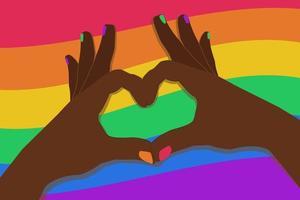 les mains à la peau foncée font un geste de coeur sur le fond d'un drapeau arc-en-ciel vecteur