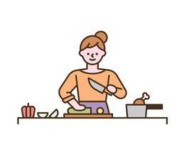 Une femme cuisine en hachant des légumes sur une planche à découper vecteur