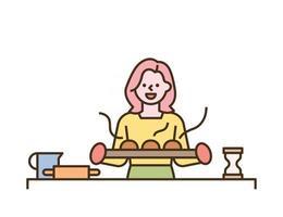 une femme tient un pain frais du four vecteur