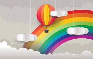 fond arc-en-ciel avec montgolfière dans un style papercut vecteur