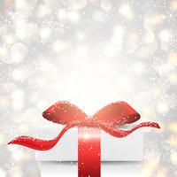 Cadeau de Noël sur fond de lumières de bokeh