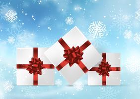 Cadeaux de Noël sur fond neigeux vecteur