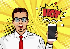 Homme souriant séduisant avec téléphone à la main dans un style bande dessinée. Illustration vectorielle pop art dans un style bande dessinée rétro. Modèle masculin de publicité numérique montrant le message ou la nouvelle application sur un téléphone por vecteur