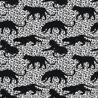 Modèle exotique sans couture avec des silhouettes abstraites des animaux.
