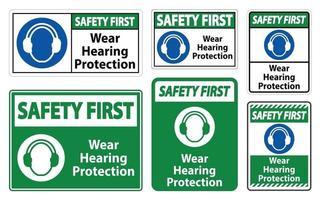 La sécurité d'abord porter un signe de protection auditive sur fond blanc vecteur