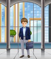 Homme d'affaires debout dans l'immeuble de bureaux vecteur