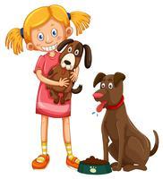 Fille avec deux chiens de compagnie