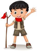 Un garçon mignon Scout sur fond blanc