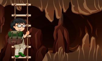 Un homme grimpe à une échelle dans la grotte