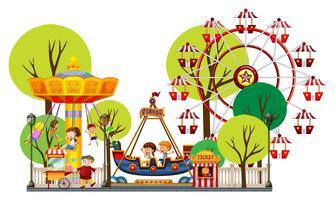 Enfants jouant dans le parc d'attractions vecteur