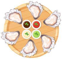 Huîtres fraîches sur assiette vecteur