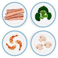 Quatre sortes d'ingrédients sur des assiettes blanches vecteur