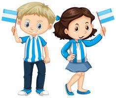 Garçon et fille tenant le drapeau de l'Argentine vecteur