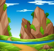 Scène avec rivière et montagne vecteur