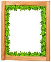 Un design de frontière en bois et feuilles vertes vecteur