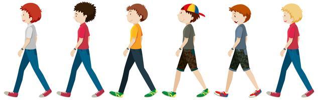 Hommes adolescents marchant sur fond blanc