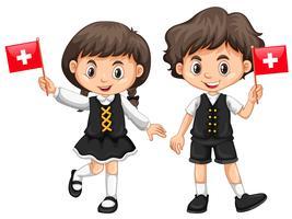 Garçon et fille avec drapeau suisse vecteur