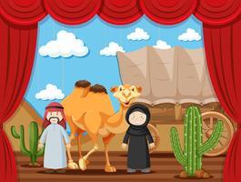 Pièce de théâtre avec deux personnes jouant des arabes dans le désert