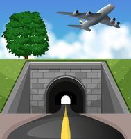 Avion survolant le tunnel vecteur