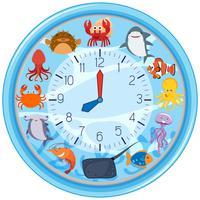 Une horloge avec un modèle de créature marine vecteur