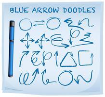 Flèche bleue griffonnage sur papier bleu