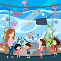 Une sortie scolaire à l'aquarium vecteur