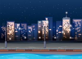 Scène avec des bâtiments la nuit vecteur