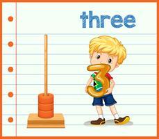 Un garçon tenant le numéro trois