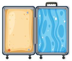 Concept de valise sable et surf