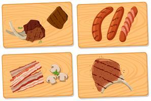 Variété de viande sur des planches à découper vecteur