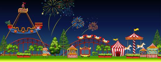 Scène de parc d'attractions de nuit